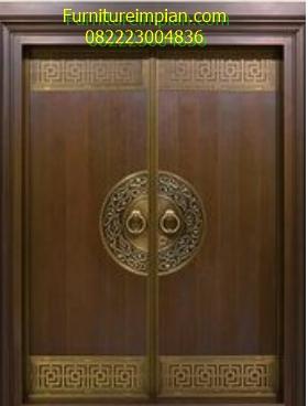 Pintu utama motif lingkar kaligrafi
